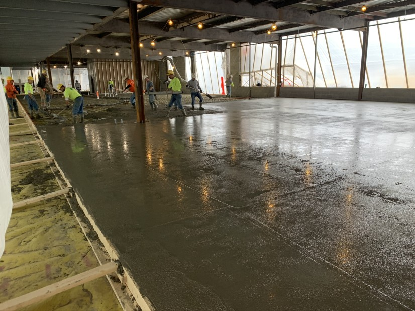Installation of concrete barrier over PCB contaminated slab